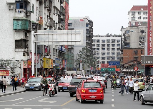 Cars are becoming more common in China, but most people have to walk, cycle or catch the bus