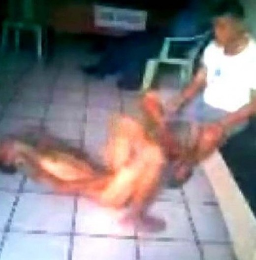 Man being tortured by policeman in the Philippines (Photo courtesy of http://www.brisbanetimes.com.au/)