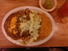 Chile Rellenos with green sauce, enchilada chicken and green sauce served with rice & beans