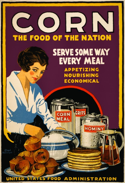 Corn, the food of the nation. Serve some way every meal: appetizing, nourishing, economical. Poster showing a woman serving muffins, pancakes, and grits, with cannisters on the table labeled corn meal, grits, and hominy. World War 1 poster for the Un