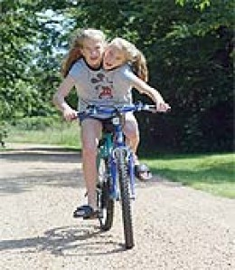 Abby and Britty riding on a bike