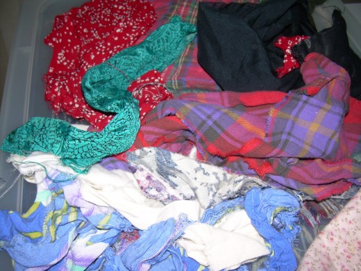 Scraps of old, beloved clothing ready to be added to a quilt