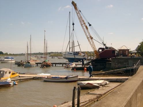 A boat being lowered back into the River Deben at Woodbridge.
