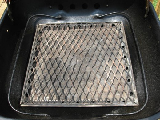 Image D - Always build your charcoal fire on a clean fire grate/ash pan.