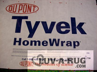 Tyvek is the best thing to wrap area rugs for storage