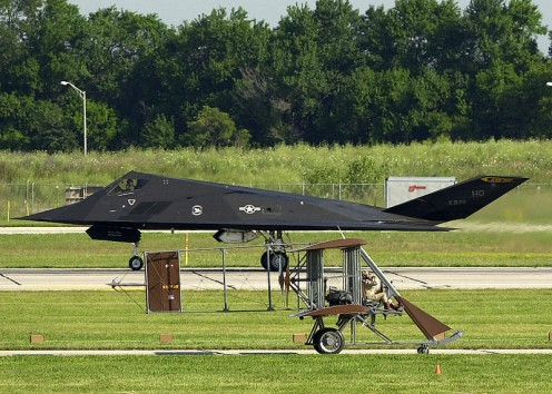 Replica of the Wright B Flyer and a USAF F-117A Stealth Fighter at the Dayton Air Show in 2003.