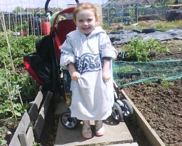 My daughter in the allotment, complete with wellies and her dad's hoodie.