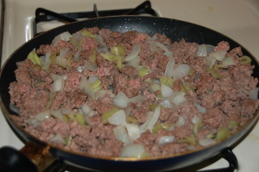 Meat, garlic, onions and banana peppers browned and ready for tomatoes.