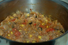 Tomatoes, salsa, black olives, and whole corn ready for the casserole dish.