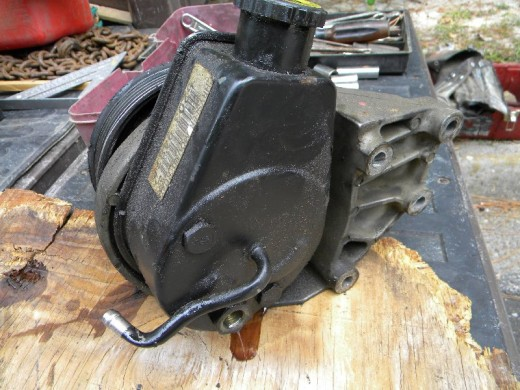 Rear of old Dodge power steering pump with line fitting removed