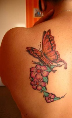 Flower butterfly tattoos on upper back