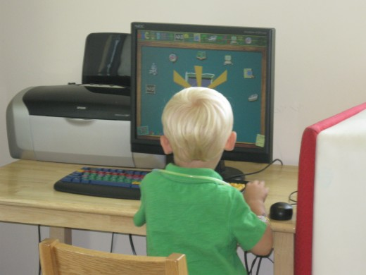 Young Alex working the computer in the children's department