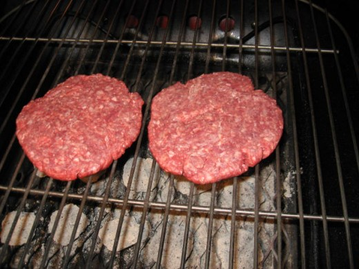 Image H - I've spread the briquets and put the clean cooking grid in place.  Now I'm grilling two juicy hamburger patties.