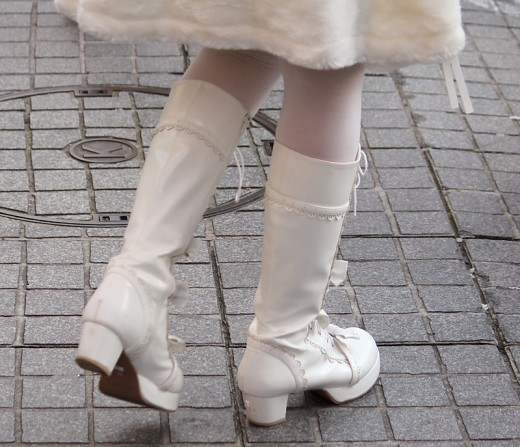 White tights team up well with a pair of black or white knee length boots