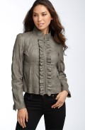 Leather jacket with ruffles as a new feminine detail.