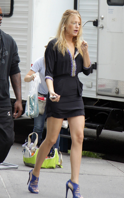 Blake Lively on set is leggy in high heels