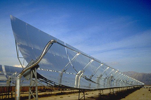 One type of solar collector uses parabolic mirrors to focus on a fluid that is then used to drive a turbine or to collect electrical power directly from heat. There are other variations, such s photo-voltaic sources, or solar powered wind turbines.