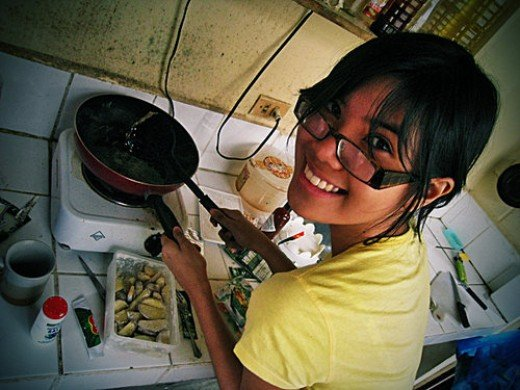 My girlfriend helping out with the cooking