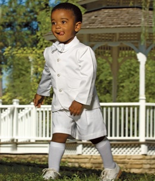The Eton suit, such as this one by Strasburg Children, is the traditional formal attire for a ring bearer, not a mini tux.