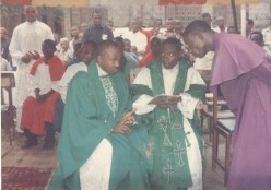AN OPEN LETTER TO GEN.MUHAMMED BUHARI (RTD):FR. KEN confering with his home Parish Priest during his First Holy Eucharist celebration on July 13, 1997.
