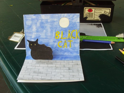 Here is a picture of the Halloween cat pop-up card that I made today.