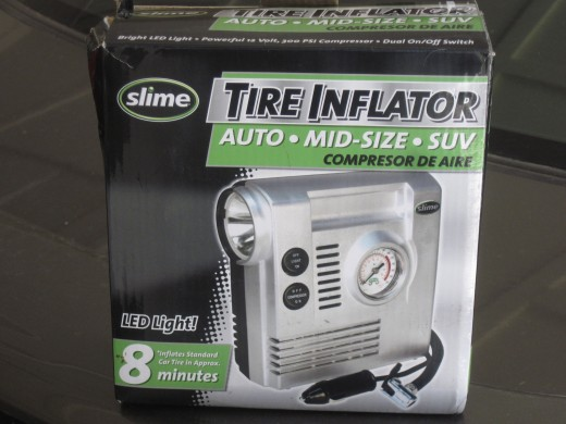 Box containing portable Tire Inflator by Slime