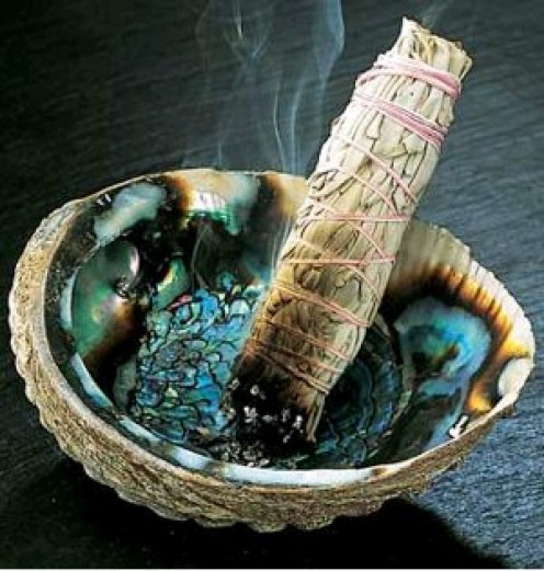 Smudge stick in abalone shell