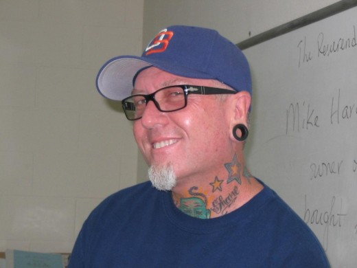 Full of tattoos and smiles, Mike Hardin is serving up some good food at Hodad's.