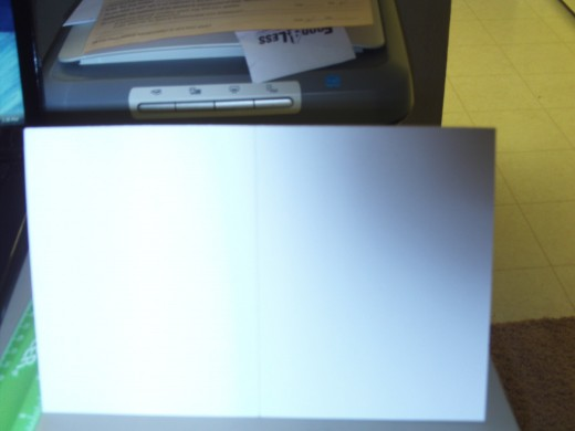 Here I fold the card stock in half to make a half fold card.
