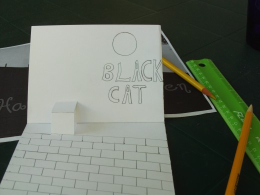 I wrote the caption Black Cat under the full moon I drew on my Halloween pop-up card.