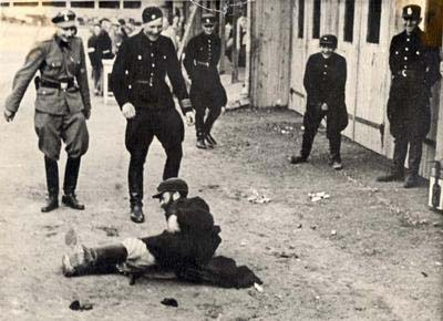 German policemen tormenting a Jew in Rzeszw, Poland. Image from Wikipedia