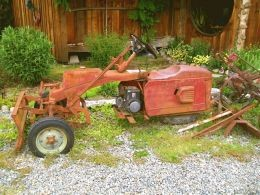 A tricycle piece of farm equipment may have had multiple uses.