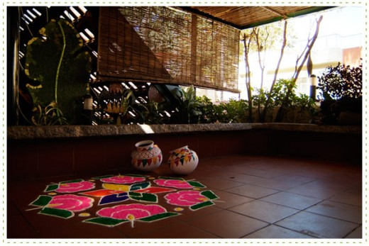 Rangolis and painted pots enhances the ethnic scene