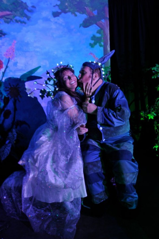 Rebecca Stier Reber, and John Edward Clark together in a scene from A Midsummer Night's Dream.