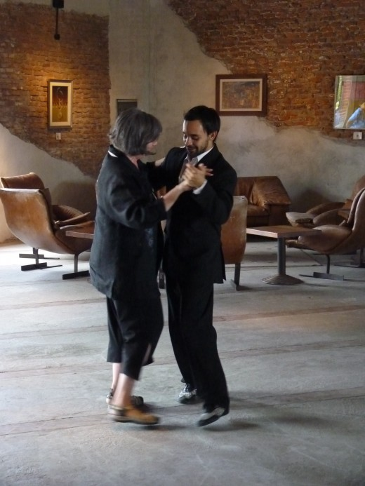 My wife learning the basic Tango steps from one of the male Tango dancers.