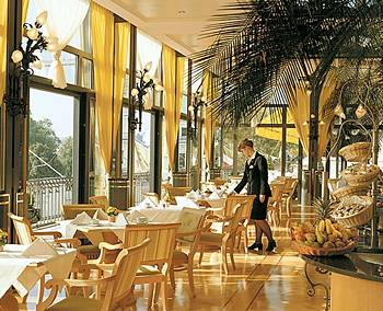 The windows provide the incredible views of Lake Geneva and the Alps.