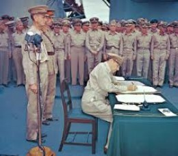 Gen. MacArthur signing Japanese surrender terms aboard USS Missouri on Sept. 2, 1945