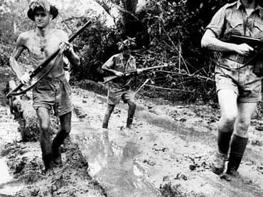 Australian Troops in the mud of the Kokoda Track, Papua-New Guinea