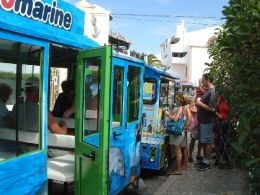 The Albufeira tourist train stops close to the Riviera Cake Shop
