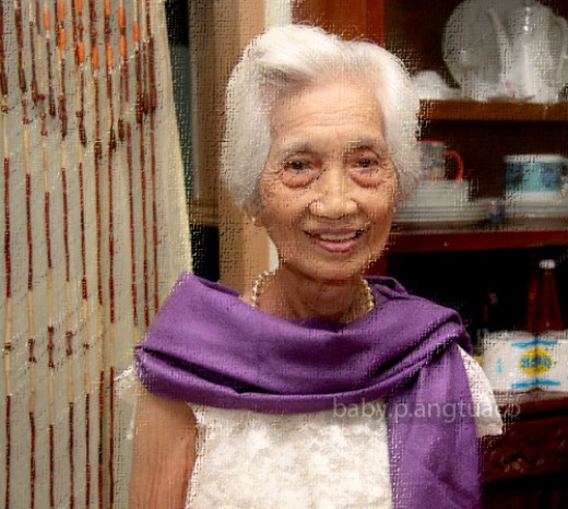 "My mom during her 90th birthday. We call her ""nanay"". I used a Photoshop filter to create this ""painting-like"" effect"