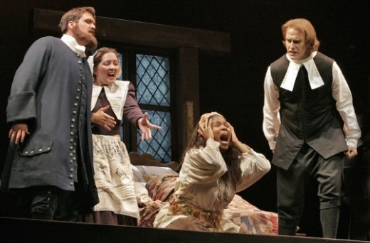 The Crucible at Utah Festival Opera: from left, Jeff Monette as Thomas Putnam, Rachel Sliker as Ann Putnam, Lori Brown Mirabal as Tituba, and Michael Jones as the Reverend Parris Photo: Ken Howard