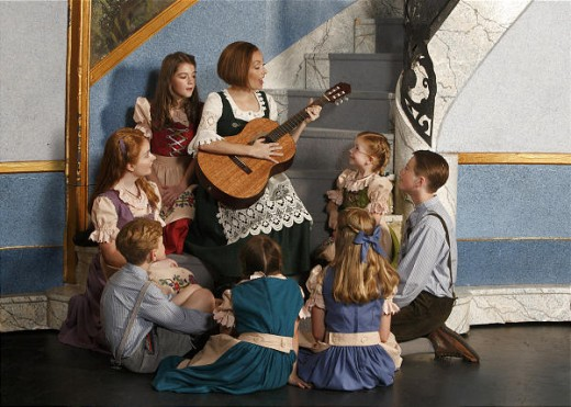 "Vanessa Ballam as Maria and the Von Trapp children sing in ""The Sound of Music."""