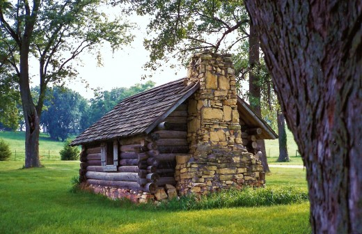 Photo of the replicated log cabin schoolhouse that Buffalo Bill attended.