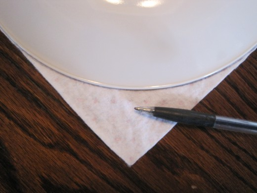 A dinner plate makes a nice curve for a crochet edge.