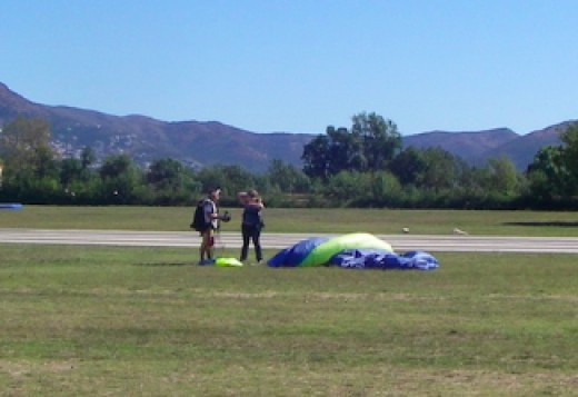 Gisela and her instructor after their tandem jump landing