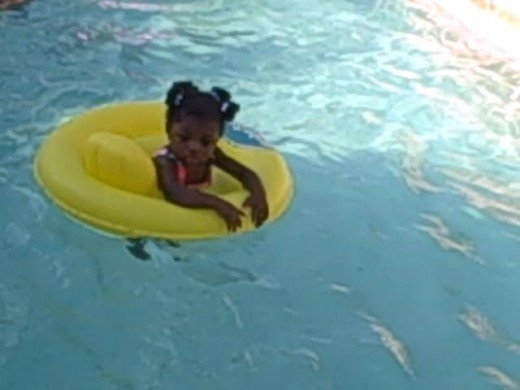 My one year old great niece floating away from me in the pool.