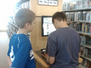Boys learn to use the online card catalog at the Bend Public Library (c) Stephanie Hicks