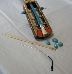 Installing beads on mosaic guitar