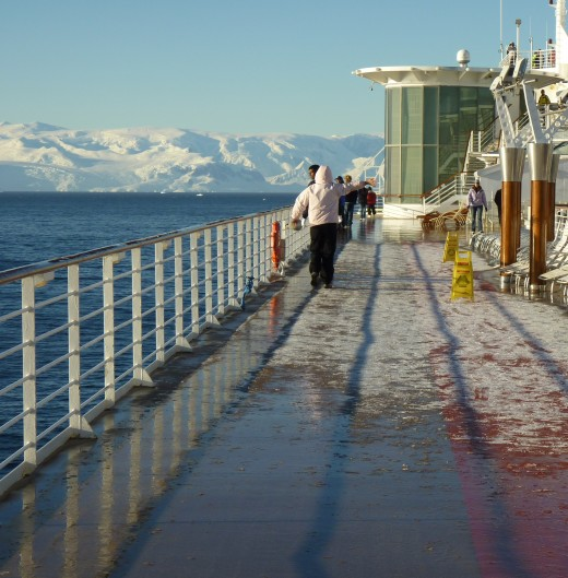 Early morning just after sunrise and the upper deck on the Celebrity Infinity is covered in ice