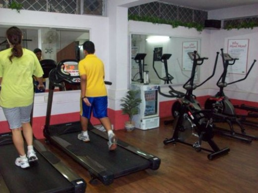 Fitness freaks working out on a treadmill at a local gym in Delhi